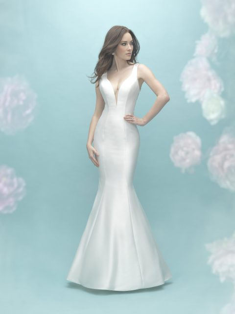 The intricate beadwork features on this mermaid gown is complemented by the Silk Mikado backdrop
